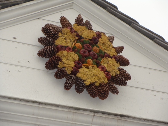 Wreath on the tavern with pomegranites and dried flowers