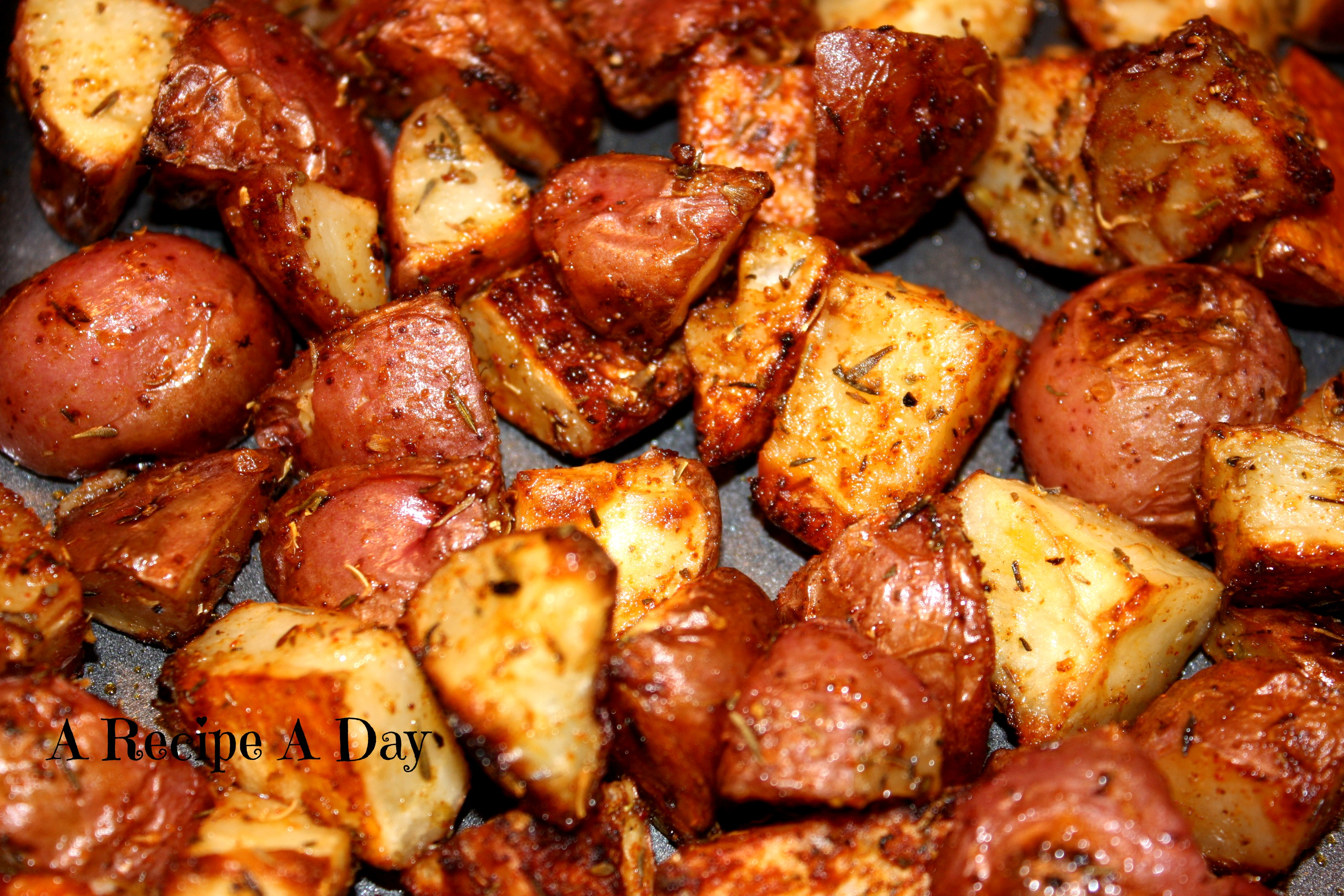 Oven Roasted Potatoes with Garlic and Herbs | A Recipe A Day
